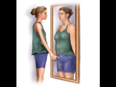 Slim person looking in the mirror seeing a larger person reflected back