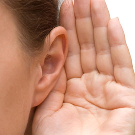 Hnad behind ear, listening