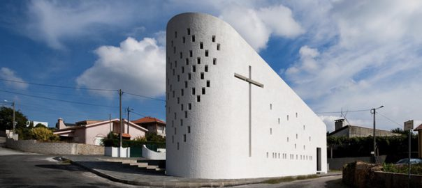 Modern, white church building on housing estate