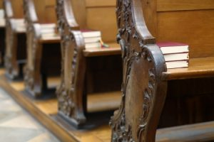 Pew ends with stacks of bibles