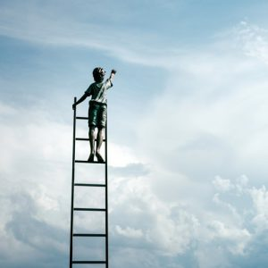 Person standing on a very tall ladder reaching into the sky