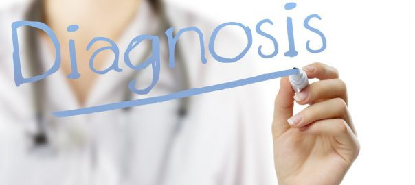 diagnosis written on screen by person in a white coat