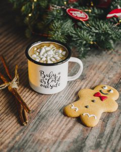 Mug of hot chocolate with marshmallows and ginger bread biscuit