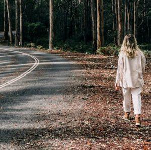 Female walking down the road looking lost