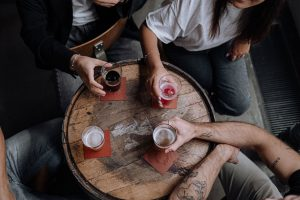 Bird's eye view of table where a group of people are drinking alcohol